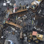 A bulldozer removes barricades at the site of recent clashes with riot police in Kiev