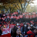 Students take part in a rally calling for President Park Geun-hye to step down in central Seoul