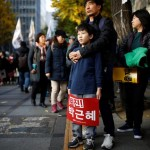 People take part in a rally calling for President Park Geun-hye to step down in central Seoul