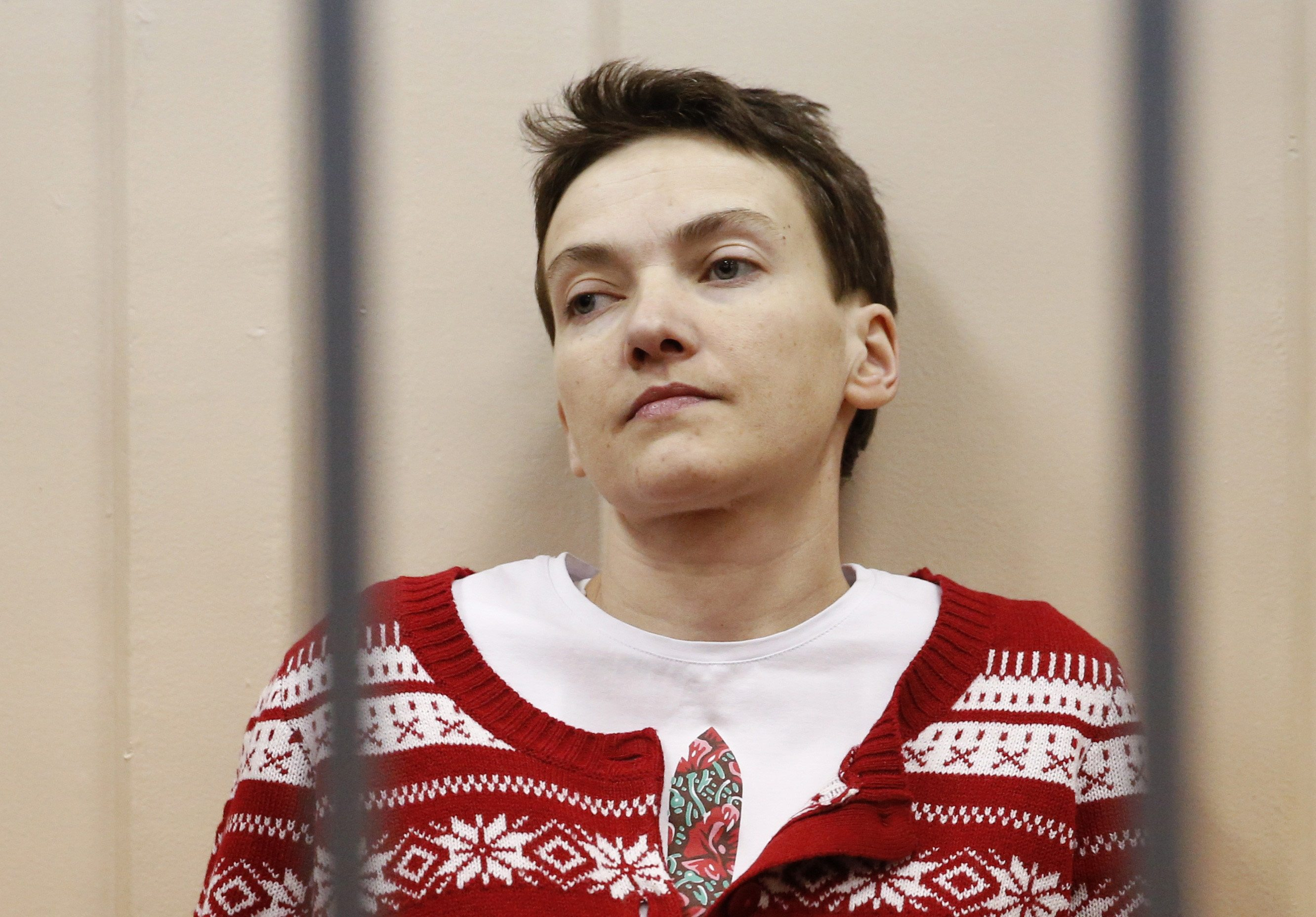 Ukrainian military pilot Nadezhda Savchenko looks out from a defendants' cage as she attends a court hearing in Moscow March 4, 2015. Savchenko, 33, was captured by pro-Russian forces and handed over eight months ago to Russia, where she was imprisoned on charges of aiding the killing of two Russian journalists in east Ukraine. At home, she has become a symbol of resistance to Russian aggression. REUTERS/Maxim Zmeyev (RUSSIA - Tags: POLITICS CIVIL UNREST CRIME LAW CONFLICT MILITARY)